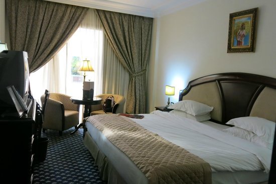 Ramada Fes: Room with a king-size bed