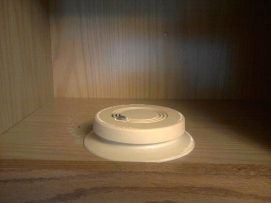 Rodeway Inn & Suites: So instead of being hooked up, our room's smoke alarm was hiding in a cabinet.