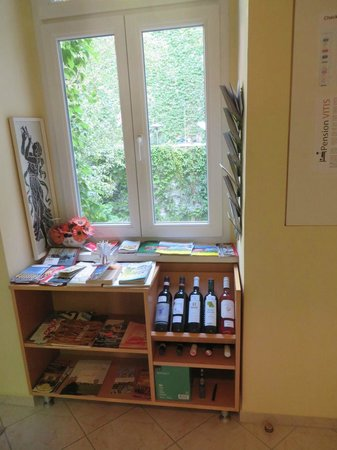 Pension VITIS: Information center in common area along with optional wine selection