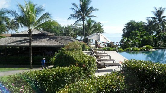 The Village Coconut Island Beach Resort: view down the pool and deli restaurant