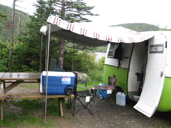 Gros Morne/Norris Point KOA: Our camper at Norris Point KOA in a lake/pond site.