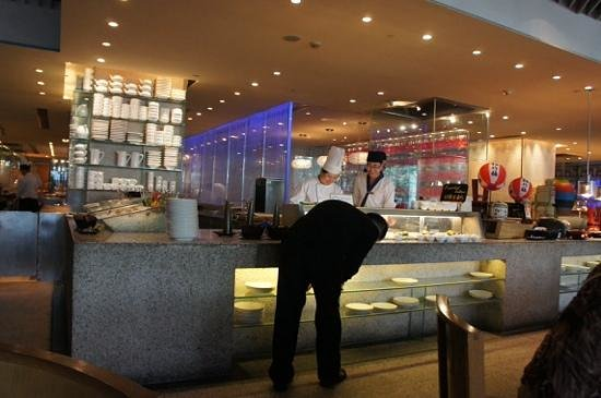 YiPin Tang: sushi chefs enjoying their work.,