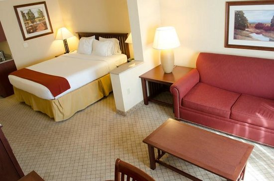 Holiday Inn Express San Dimas: The room is spacious with a desk, chair, couch and small table