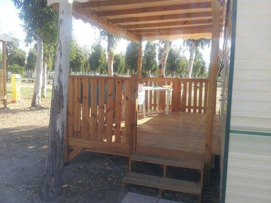 Camping Village Laguna Blu : decking outside bungalow