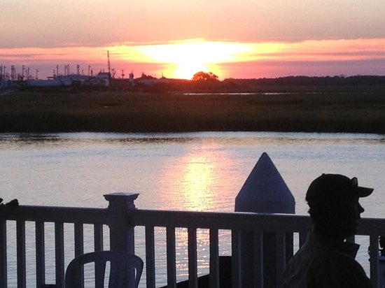 The Crab House: Sunset from our table, through the plate glass window.