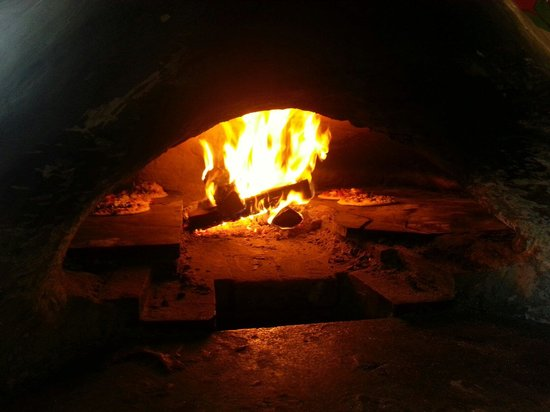 Rocky Mountain Flatbread Company: Our pizzas cooking!