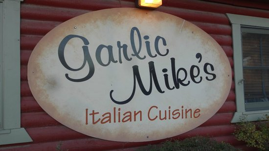 Garlic Mike's Italian Cuisine: Sign out front just North of the Gunnison River bridge