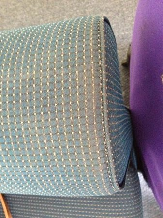 Alex Beach Cabins & Tourist Park: well worn arm of small couch