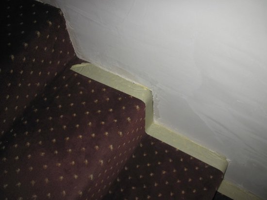 France Eiffel Hotel: tape holding carpet down,
