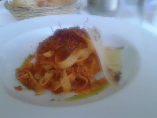 Di Paolo: Fettuccine with meat  ragu', tomato sauce and shaved parmesan cheese.