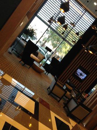 Amari Doha Qatar: Part of hotel lobby - as seen from coffee shop