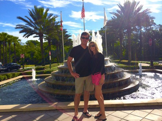 Waldorf Astoria Orlando : My husband and I standing by the front fountain awaiting the hotels shuttle to the Disney Parks