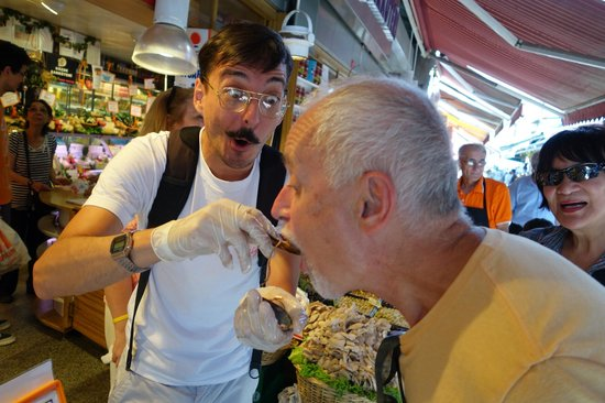 Culinary Backstreets -Tours: Angelis feeding us mussels & rice street food