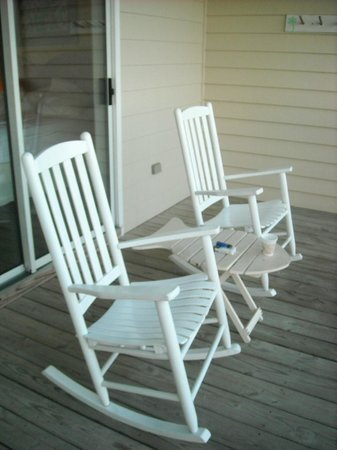 The Sunset Inn : Rocking Chairs on Private Screened Porch