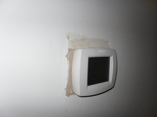 Nomi Resort: Thermostat...fix the wall first!