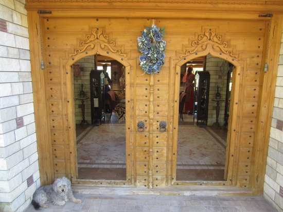 Cool front door with carved wood picture of kerme for Cool front doors