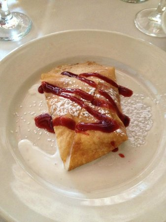Bertrand's Bistro: Crepe filled with peaches and vanilla ice cream, drizzled with raspberry