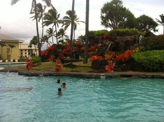 Kauai Beach Resort: One of 4 pools, evening show.