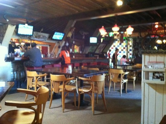 Point Break Cafe: bar on the left of photo with TVs for sports games