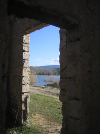Lisi Lake: Old abandoned buildings along the road on far side of lake.