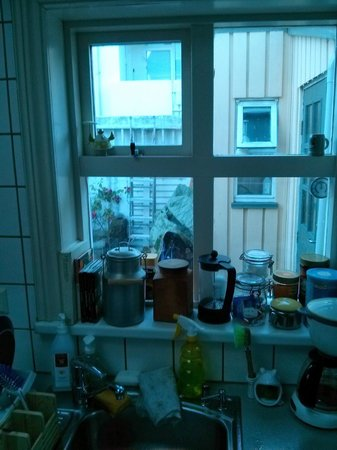 Konrad's Guesthouse : the view from the kitchen, beyond the tea you can see the bikes