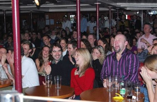 a bunch of happy people at the Boat Show Comedy Club
