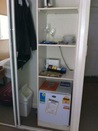 Phoenician Resort - Broadbeach : small bar fridge inside the wardrobe