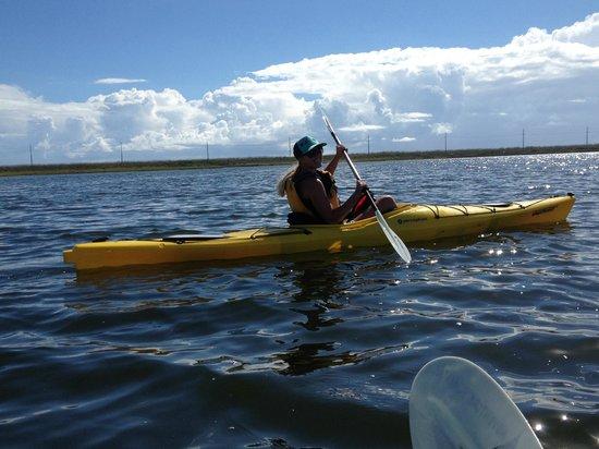 The Villas at Koru Village: Ellisa guiding us in our Kayak