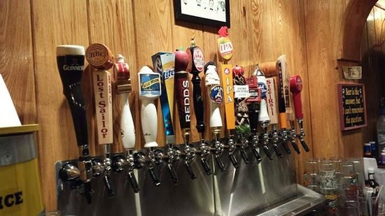 Adams Ale House: Updated Tap selection on back wall as of 9-13-13
