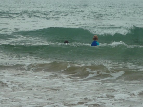 Broadwater Haven : boys trying out some waves, early morning tide coming in around 7.30am