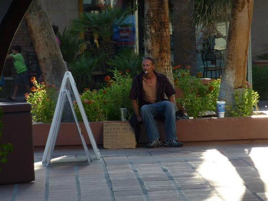 Palm Springs Visitor Information: Homeless in front of See's Candies