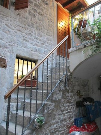 Salvezani Apartment: Staircase from courtyard to apartment door (another staircase is behind that door)