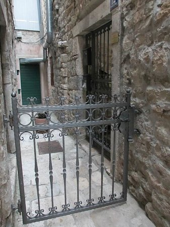 Salvezani Apartment: Gate leading to second gate on the right, which leads to the courtyard