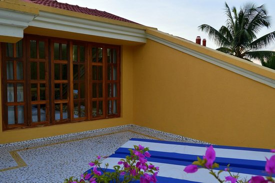Bougainvillea Guest House Goa : French windows of the penthouse suite overlooking the terrace
