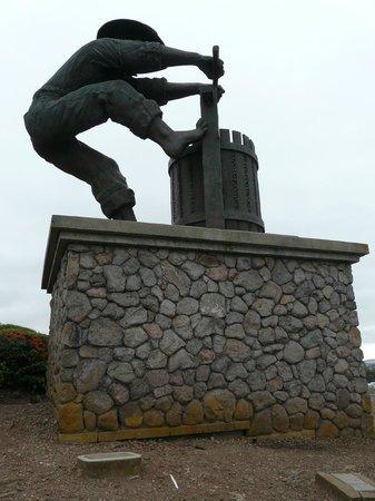 The Meritage Resort and Spa: Grape Crusher Statue at top of resort vineyard