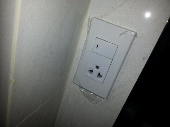 Boss Suites: Sticky tape holding the power point to the wall