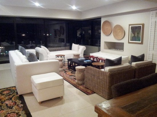 Ultra modern and stylish lounge area leading out to pool on deck ...