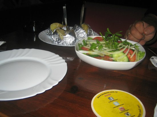 carina sports bar rest.: Jacket potatoes and salad  to the meat platter.Very good. choose between jacket potato or chips