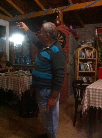 Celik Apart Hotel: Hasan in garage of the TV