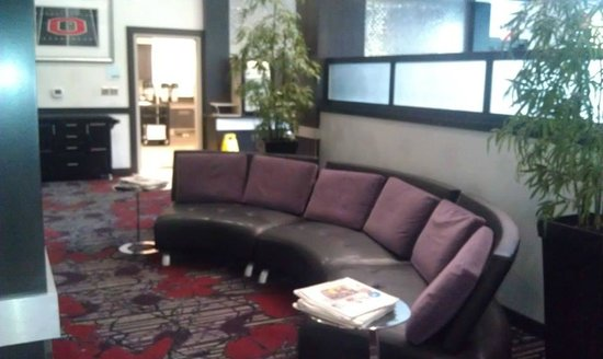 "Holiday Inn Express & Suites Columbus-Polaris Parkway: This long sofa faces a flat screen tv and ""fireplace""."