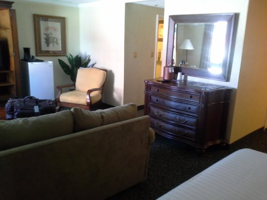 "El Cortez Hotel & Casino: ""Couch/TV/Fridge/Entrance"" area"