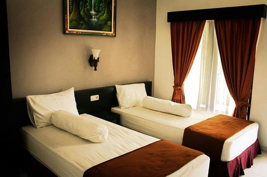Warapsari Inn : Twin bed