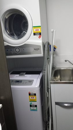 Central Kensington by Vivo: Laundry - In cupboard at other side of Bathroom