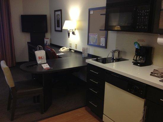 Candlewood Suites - Des Moines: desk and part of kitchen