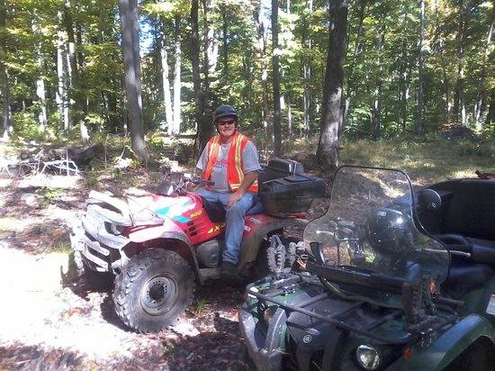 Hidden Cove Cottage Resort: Rick back in the bush on his ATV
