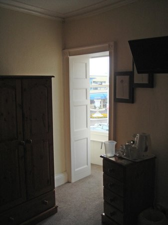 The Beach House: From second floor room through doorway to pier