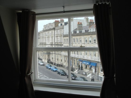 The Beach House: Top floor street window