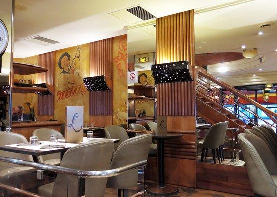 Warm art deco inspired decor of the interior of Le Lutece