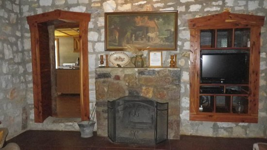 Panther Valley Ranch: Fireplace, doorway to kitchen, and the built in entertainment unit in the den!