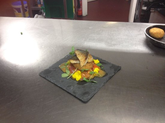 Artisan: Pan fried mackerel with a mackerel fish cake and a red onion and tomato salad